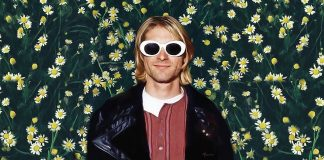 Kurt Cobain wearing white sunglasses with a floral background