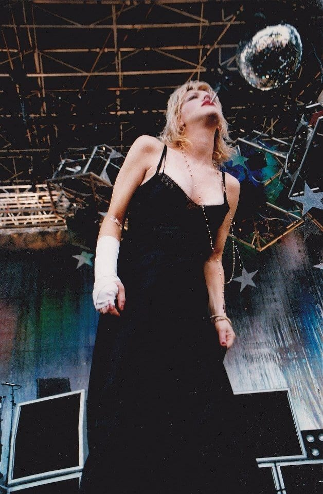 Courtney Love wearing a black dress