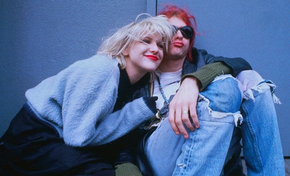 Kurt and Courtney with sweater and ripped jeans