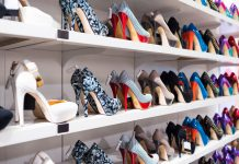 Rows of platform shoes on shoe shelf