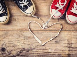 Converse with laces tied in a love heart