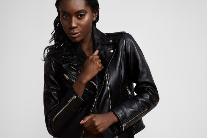 black woman wearing classik biker jacket with that punk 90s look
