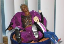 Plastic MC Hammer Figure wearing purple jacket and trousers with seth godin