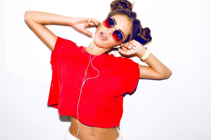 Female wearing a red crop top with sunglasses