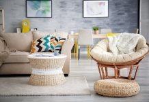 Wicker furniture in a 90s living room with painted walls