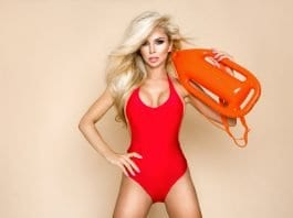 Lifeguard with blonde hair holding a lifebuoy