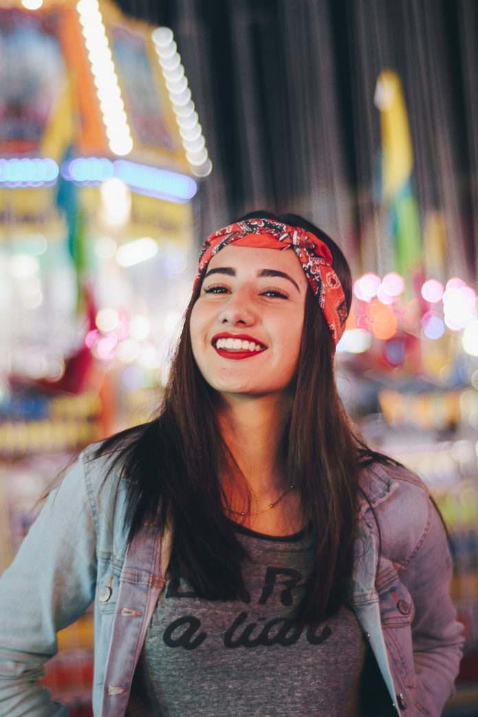 Woman wearing a classic red bandana with bright red lipstick