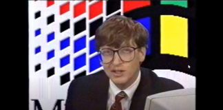 Bill Gates wearing a dapper suit and red tie introducing Windows