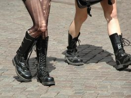 two girls walking with ripped tights and combat boots