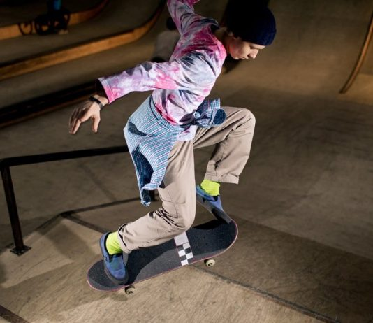 a skater wearing tie dye and 90s style clothing