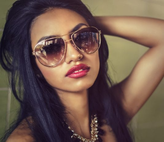 Chola Style woman wearing sunglasses and red lipstick