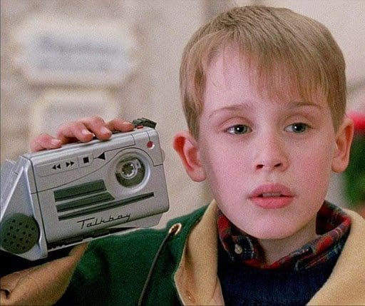 Kevin McAllister from home alone holding a talkboy home alone