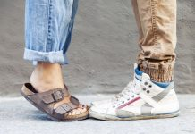 woman wearing boyfriend jeans next to man wearing brown corduroys and sneaker hi tops
