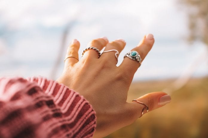Woman wearing 90s jewelry rings