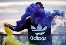 Woman wearing a purple adidas sweatshirt
