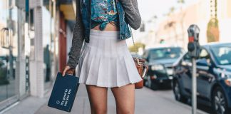 A woman wearing a white mini pleated skirt on the street
