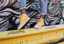 Woman wearing yellow hi top converse