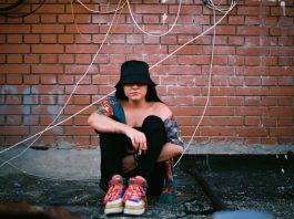 Woman Wearing Black Bucket Hat with 90s Style Clothes